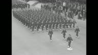 'World News' superimposed over spinning globe / Title card 'A WarWeary France Recalls the Bastille' superimposed over WS French soldiers marching in...
