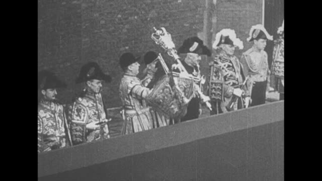 'England' superimposed over British Coat of Arms / Coat of Arms / two shots of funeral procession of King George V / Garter King of Arms proclaims...
