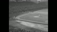 'Fifth Game Cubs 3 Tigers 1' superimposed over WS baseball field of Chicago's Wrigley Field as Cubs' Chuck Klein hits a home run / title 'Sixth Game...
