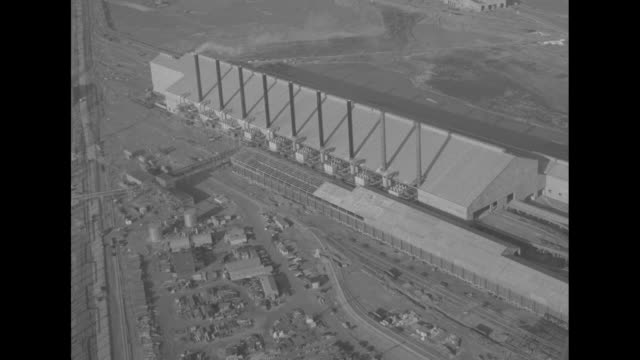 Title 'Fire furnaces of 'Steel Plant of Tomorrow' 'superimposed over aerial view Fairless Works / various shots aerial view Fairless Works new steel...