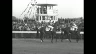 Title 'Kentucky Derby 1933' superimposed in horseshoe over horse / title 'Churchill Downs 'Broker's Tip' noses out 'Head Play' before 50000 to win...