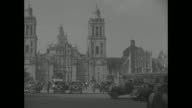 'Mexico City' superimposed over exterior of Metropolitan Cathedral of the Assumption / playwright George Bernard Shaw holding umbrella and...