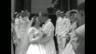 'Middie Grads in Full Steam for Altar' superimposed on the US Naval Academy Chapel / bride and groom exit chapel underneath crossed swords they stop...