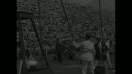 'Marks Set In PreOlympic Track Tests' / Title 'Princeton NJ' superimposed over crowd in stands / two shots of 100meter dash Jesse Owens winning /...