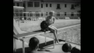 'Next day the stars relaxed They played at the famous Broadmoor Hotel and visited many of the beautiful nearby sights' / Virginia Mayo sitting next...