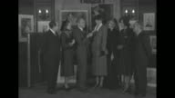 'Paramount B'ldg NY Aid for Refugees' superimposed over Jack Benny Eleanor Roosevelt and two others look at framed art / MS group / SOT Benny sells...