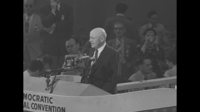 'Sen Sparkman Named As Convention Ends' superimposed over VicePresident Alben Barkley waving from rostrum in International Amphitheatre at Democratic...
