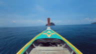 WS t/L POV Longtail boat navigates from Ko Phi Phi Don island to Mosquito island then to Bamboo island / Phi Phi islands, Krabi, Thailand