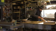WA PAN to carpenter using hand tools in his workshop