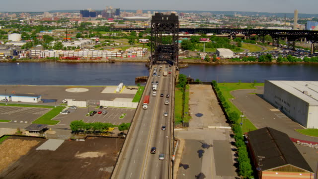 WIDE to CLOSE UP ERIAL POV over Lincoln Highway Lift Bridge with traffic