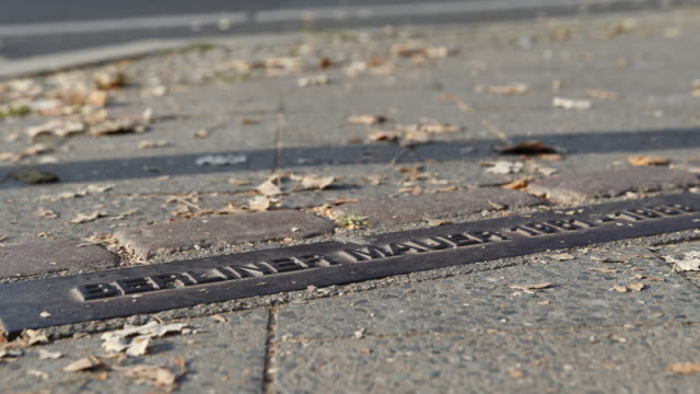 To commemorate the history of the Berlin Wall which divided Berlin from 1961 to 1989 a metal plate with the information'Berliner Mauer 19611989' is...