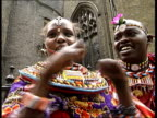 London Members of Masai tribe in tribal dress posing for photocall with one holding up injured hands
