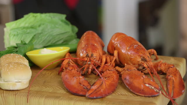 PAN to lobsters on cutting board