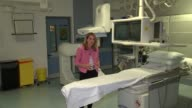 NHS to make new treatment for strokes available Reporter to camera Brain scan on screen Alexis Wieroniey interview SOT