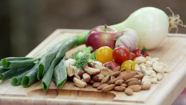 TILT DOWN to vegetables, fruits and nuts