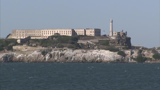 HD ZO to XWS Alcatraz Island in San Francisco Bay XWS sailboat passing in bay area FG CA The Rock landmark