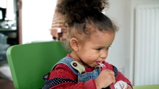 HD: Toddler eating her Yogurt