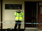 Toddler stabbed to death in East London ENGLAND East London EXT Flats where toddler was killed Police officer behind cordoned off area outside flats...