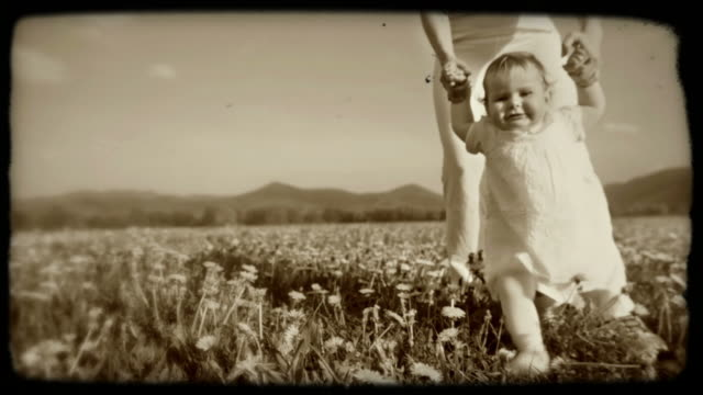 HD SLOW-MOTION: Toddler Walking On A Meadow