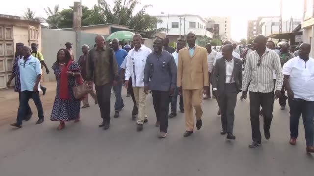 Togo's opposition visits the burnt headquarters of Panafrican National Party in Lome