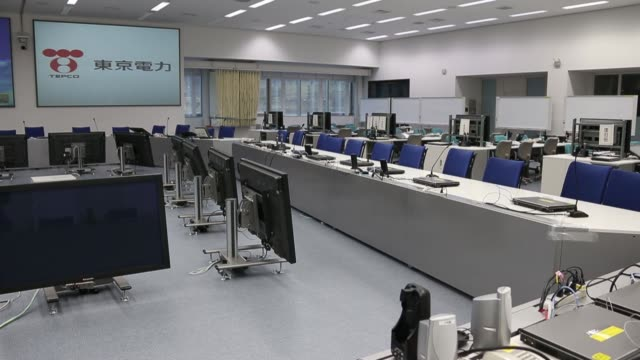 Tokyo Electric Power Co employees take part in a drill in the simulator of the central control room for a reactor inside the seismic isolated...