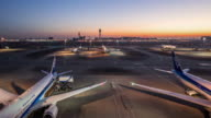 T/L WS HA PAN Tokyo Haneda International Airport Night to Day Transition / Tokyo, Japan