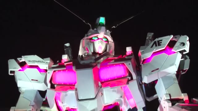 A statue of the Unicorn Gundam robot from the 'Mobile Suit Gundam Unicorn' anime series is unveiled in Tokyo's Odaiba waterfront area on Sept 23 2017...