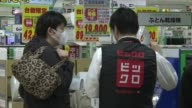 Tokyo residents splash out the yen in a last minute buying spree as millions of Japanese shoppers brace for the countrys first sales tax hike since...