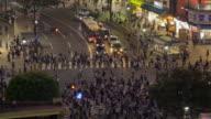 Tokyo Shibuya cross walk high above Street Traffic People
