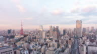 Tokyo Tower and buildings get sunshine time lapse in the early morning