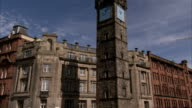 Tolbooth Steeple casts a shadow on nearby buildings in Glasgow. Available in HD.