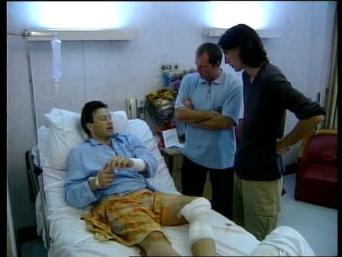 Jakarta Injured ITN reporter Tom Bradby laying in hospital bed talking with ITN crew CS Bradby MS Bradby talking with crew
