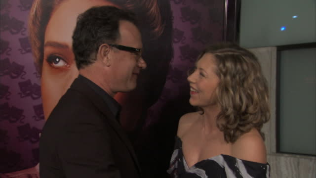 HD Tom Hanks actress Branka Katic standing together on red carpet outside Cinerama Dome posing for press photographs Hanks joking w/ photographers