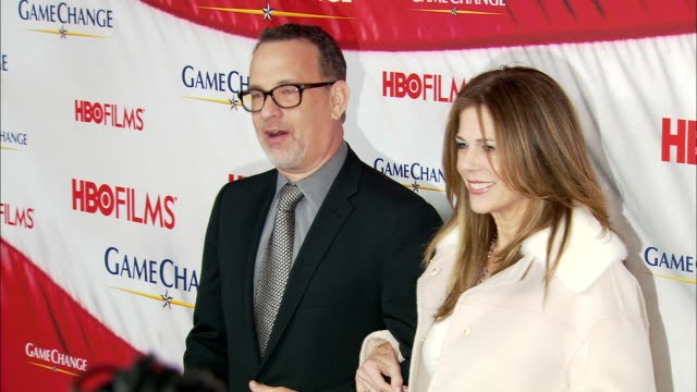 Tom Hanks and Rita Wilson posing for paparazzi along the red carpet at the Ziegfeld Theater