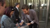 Tom Mison leaving SiriusXM Satellite Radio poses with and signs for fans on September 23 2014 in New York City