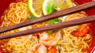 Tom Yum Soup with chopsticks