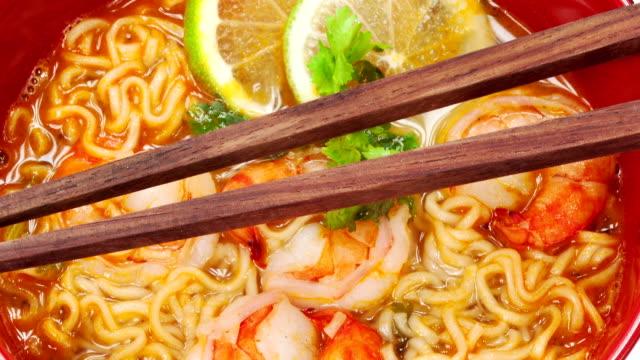 Tom Yum Soup with chopsticks