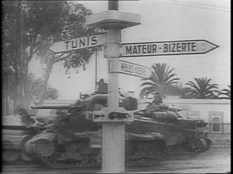 Tommy guns rout last Nazi snipers as civilian populace hysterical with joy greets Allied visitors / Allied tanks roll by Tunis and MateurBizerte...