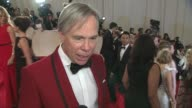 Tommy Hilfiger talks about McQueen's use of the Union Jack in the same way he uses the American flag jokes about losing his wife at the 'Alexander...