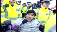 Tommy Sheridan wins libel case against News of the World TX EXT Sheridan being carried away by police after protest outside nuclear submarine base