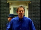Baby Leo born ENGLAND London Downing Street Man delivering large bouquet of flowers to No10 GBV Press waiting opposite No10 MS PM Tony Blair holding...