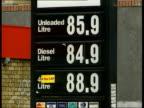 Tony Blair defends tax rates ITN London Texaco petrol station Price sign at garage Garage Man filling car at petrol station Elf petrol station