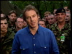 Tony Blair stands before troops talking of his pride that people of Kosovo have been able to return home with help of British troops Kosovo 30 Jul 99