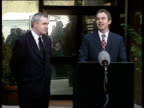 Tony Blair stands with Irish Prime Minister Bertie Ahern to make speech to press urging politicians and people of Northern Ireland to