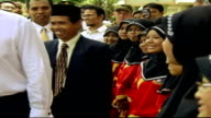 Jakarta EXT Tony Blair MP watching school band perform during visit to Islamic boarding school Group of pupils wearing white headscarves playing...
