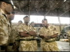 Basra EXT Tony Blair MP along to meet British troops PAN Blair posing with soldiers for photo opportunity BV Blair shaking hands with Iraqi support...