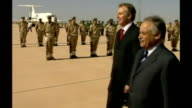 EXT Tony Blair along red carpet past honour guard Female troops lined up during official welcoming ceremony Low Angle shot Blair along with officials