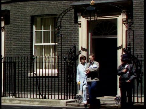 Tony Blair walks out of No10 Downing Street to awaiting car with newborn son Leo Blair in his arms Cherie Blair at their side 27 May 00