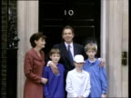 Tony Blair waves with wife Cherie and children Nicholas Kathryn and Euan pose for press outside 10 Downing Street on day he became Prime Minister 02...