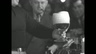VS Tony Galento with Joe Jacobs pours a beer behind of his tavern's bar puts large foamy glass on bar proceeds to start drinking it / Max Baer...